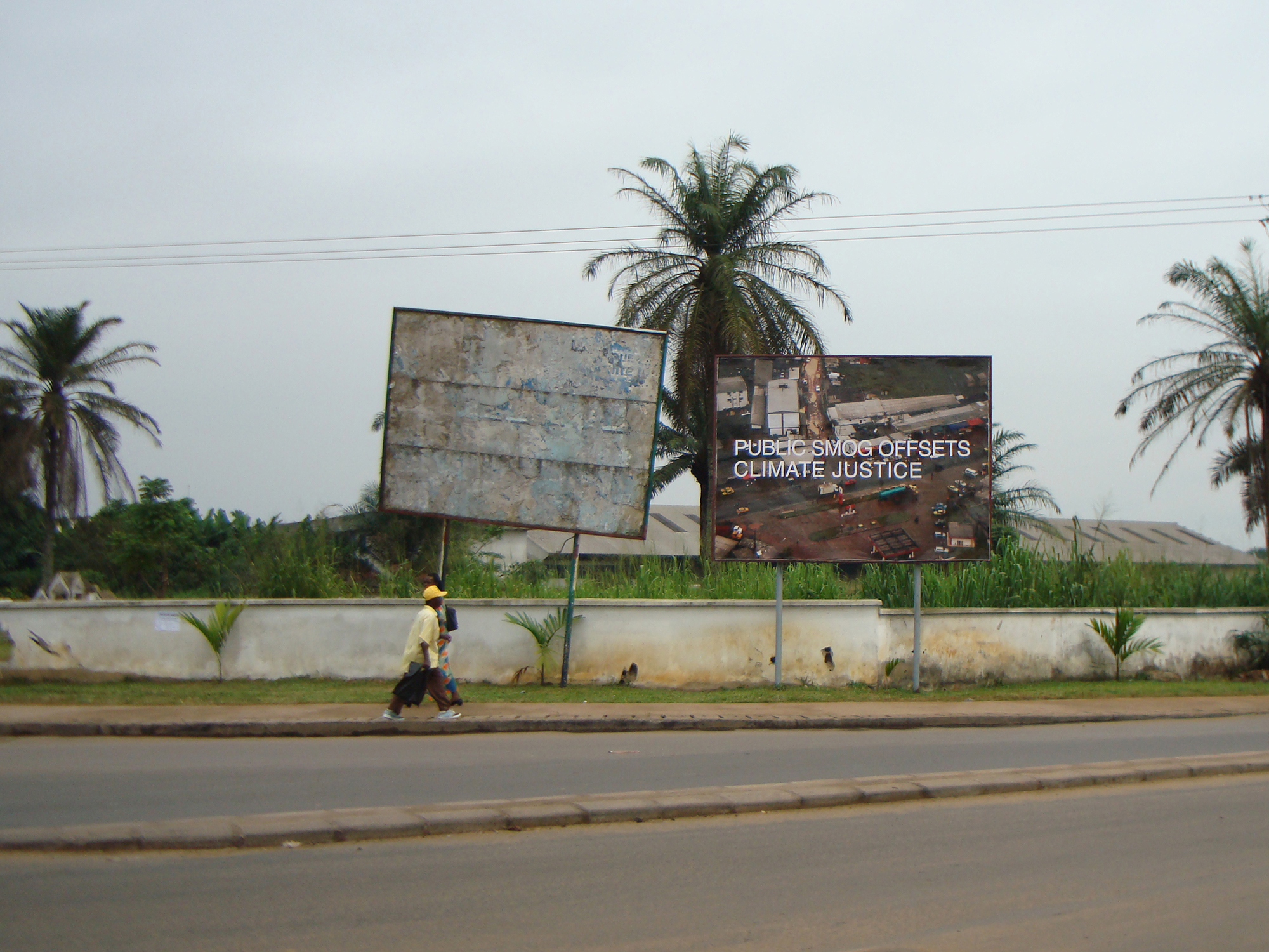 Figure 2. Public smog offsets climate justice. Billboard, Ndokoti, Douala, Cameroon, 2009. Image: Benoît Mangin. Part of Amy Balkin, Public Smog, used with permission